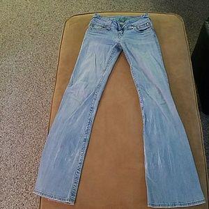 Faded light denim flare bottom hydraulic jeans